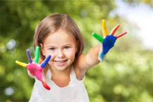 Girl with colorful hands